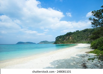 Deserted white sand tropical beach with clear blue water, Iriomote Island National Park of the Yaeyama Islands, Okinawa, Japan
