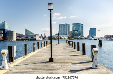 Deserted Wooden Jetty with Electric Sockets and Mooring Poles at Baltimore Harbour on a Sunny Autumn Day