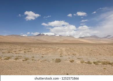 Desert-like landscape along the famous Pamir Highway in Tajikistan