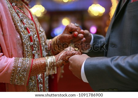Desi Couple Holding Hands At Their Wedding