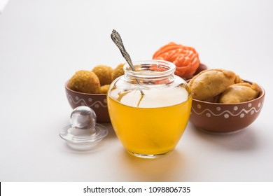 Desi Ghee with Indian sweets like Gujiya, Motichoor laddu and imarti or Jalebi