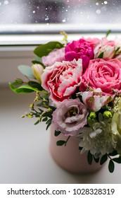 Design bouquet on the windowsill