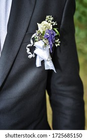 Design a boutonniere. Wedding day. Beautiful boutonniere of the groom. Grey suit.