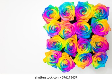 Design of boxes with colorful roses. Decoration with flowers. Gift.