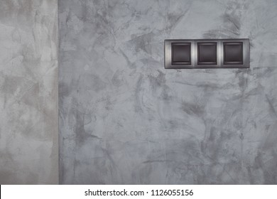 Design cement wall texture with modern electrical switch.