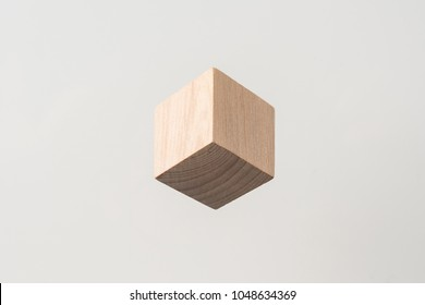 Design concept - abstract geometric real wooden cube with surreal layout on grey background , it's illusion like  hexagon, and it's not 3D render
