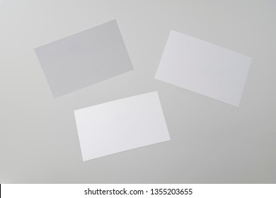 Design concept - front view of 3 surreal white business card float on mid air isolated on white background for mockup, it's real photo, not 3D render
