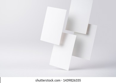 Design concept - front view of 4 surreal white business card float on mid air isolated on white background for mockup, it's real photo, not 3D render