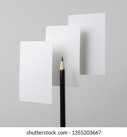 Design concept - front view of surreal white business card with pencil float on mid air isolated on white background, it's leadership, strength concept