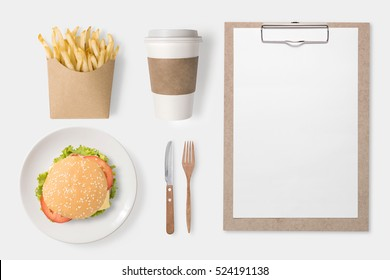 Design concept of mockup burger, french fries, coffee cup and clip board set isolated on white background. Copyspace for text and logo. Clipping Path included on white background.