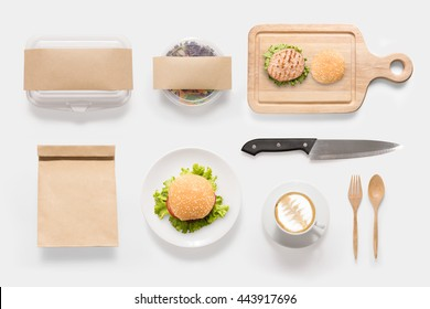Design concept of mockup burger, salad and coffee cup set on white background. Copy space for text and logo. Clipping Path included on white background.