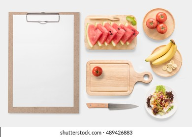 Design concept of mockup fresh vegetable, fruits and clip board set isolated on white background. Copy space for text and logo. Clipping Path included on white background.