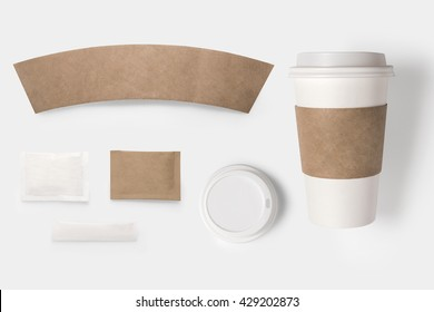 Design concept of mockup paper, sugar, coffee creamer, toothpick, lid and coffee cup set on white background. Copy space for text and logo. Clipping Path included on white background.