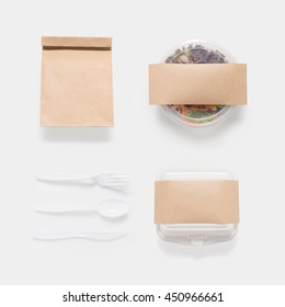 Design concept of mockup salad, bag and container box set isolated on white background. Copy space for text and logo. Clipping Path included on white background.