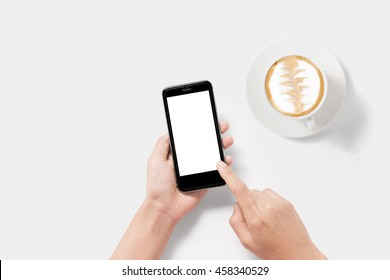 Design concept of mockup using smartphone and coffee set isolated on white background. Clipping Path included on white background. Copyspace for your text.