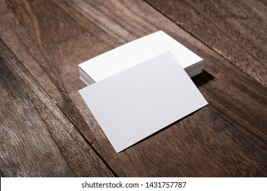 Design concept - perspective view of white business card on wood floor background for mockup