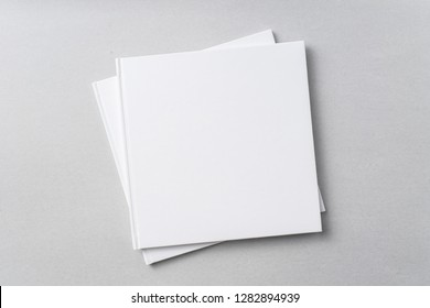 Design concept - Top view of 2 pure white notebook on grey background for mockup
