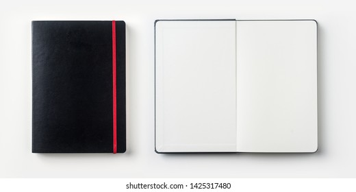 Design concept - top view of black notebook with red binder and pen isolated on white background for mockup. real photo, not 3D render