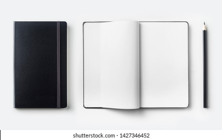 Design concept - top view of black notebook and pen isolated on white background for mockup. real photo, not 3D render