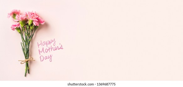 Design concept - top view a bunch of carnation with hemp rope on pink background for mother day mockup