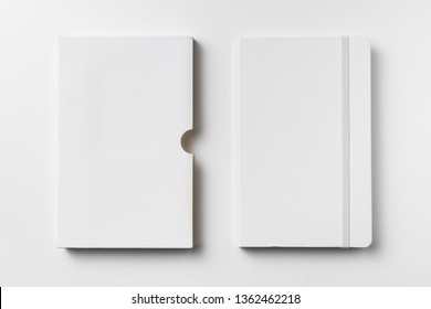 Design concept - top view of close white notebook with elastic band, case isolated on white background for mockup. real photo, not 3D render
