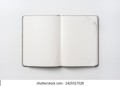 Design concept - top view of fabric hardcover notebook blank page isolated on white background for mockup. real photo, not 3D render
