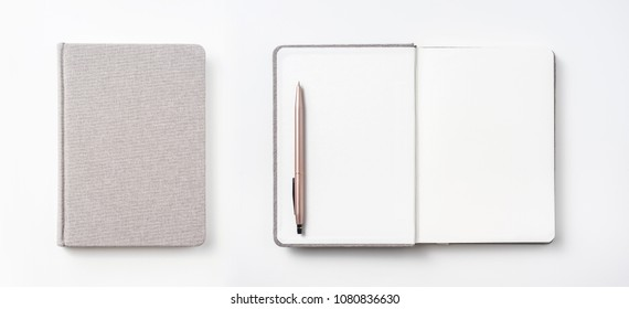 Design concept - Top view of hardcover gray linen notebook and ballpoint pen isolated on white background for mockup