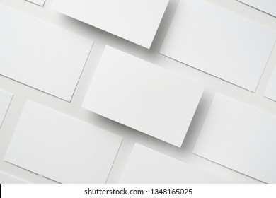 Design concept - top view of horizontal business card isolated on white background for mockup, it's real photo, not 3D render