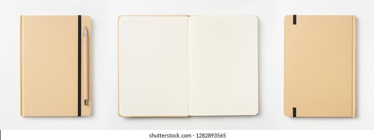 Design concept - Top view of kraft paper notebook, white page and pencil isolated on background for mockup