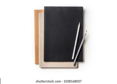 Design concept - Top view of many notebooks and 2 color pencil isolated on white background for mockup