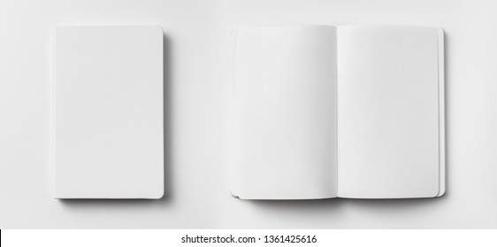 Design concept - top view of open and close white notebook with elastic band, blank page isolated on white background for mockup. real photo, not 3D render