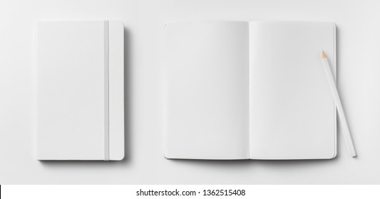 Design concept - top view of open and close white notebook with elastic band, blank page and wooden pencil isolated on white background for mockup. real photo, not 3D render