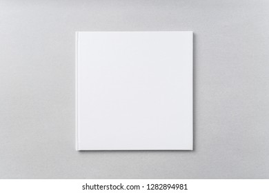Design concept - Top view of pure white notebook, white page on grey background for mockup