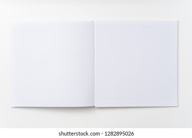 Design concept - Top view of pure white notebook, white page isolated on background for mockup