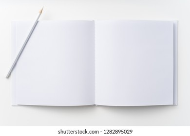 Design concept - Top view of pure white notebook, white page and pencil isolated on background for mockup