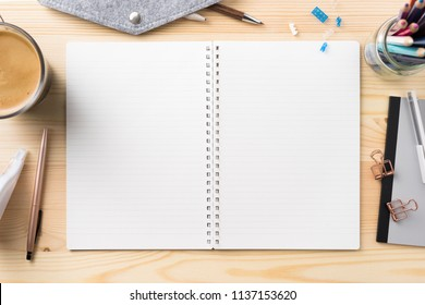 Design concept - Top view of lot of stationary, like black spiral notebook and wood mechanical pencil…etc on wood table background for mockup