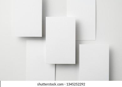 Design concept - top view of vertical business card isolated on white background for mockup, it's real photo, not 3D render
