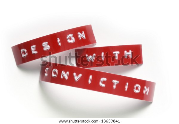 """Design with conviction"" done in old-fashioned punch-style lettering"