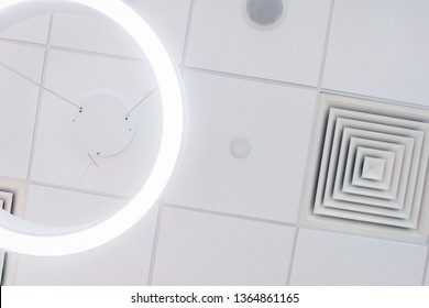 Design and details of the modern device ceilings in the room. Devices for ventilation and air conditioning, ceiling speakers and lighting devices. Details of the modern interior.