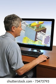 Design Engineer at Work on a Computer