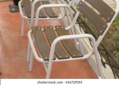 design of gray and brown plastic chair in the park
