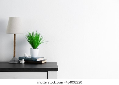Design interior with lamp and plant on white wall background