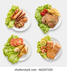 Design of mockup BBQ grilled sausages, chicken, salmon, pork chop, beef set isolated on white background. Clipping Path included on white background.