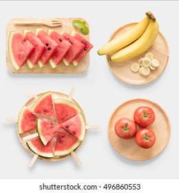 Design of mockup healthy watermelon, watermelon ice cream, banana and tomato on wooden dish set isolated on white background. Clipping Path included on white background.