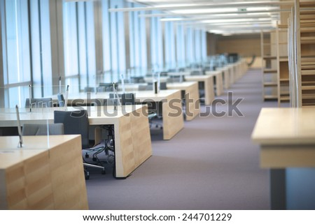 Design of new department office; row of empty tables