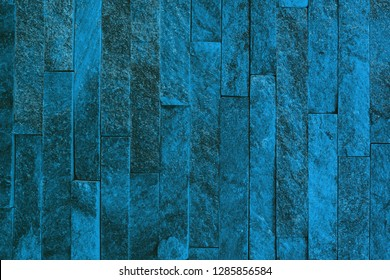 design old light blue natural quartzite stone bricks texture for use as background.