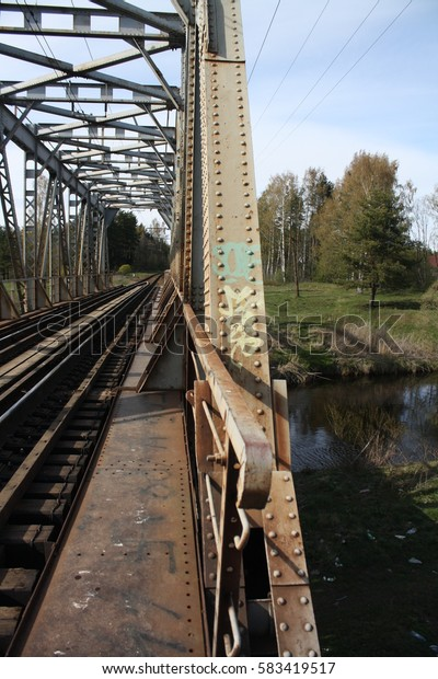 the design of the old metal bridge over the river