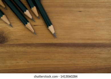 Design pens on wood background