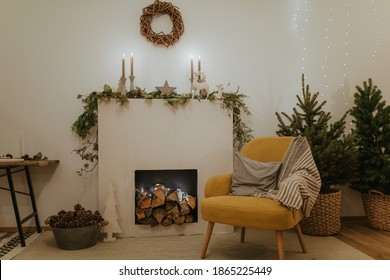 Design room with Christmas tree, fireplace. Interior eco style. Christmas decorated interior of couch and Christmas tree, modern and cozy. happy new year and merry christmas