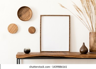 Design scandinavian interior of living room with wooden console, rings on the wall, mock up poster frame, flowers in vase and elegant personal accessories. Modern home decor. Template. - Shutterstock ID 1439886161